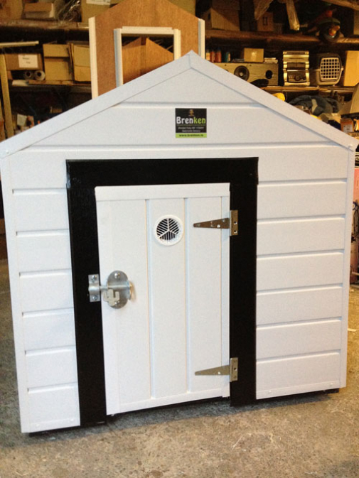 Large Brenken kennel with black metal surround at door opening